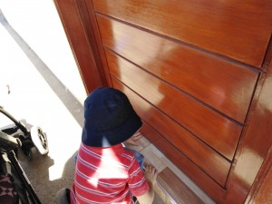 Little hands helping to slide Easter invitations under doors